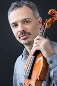 colin jacobsen with a violin
